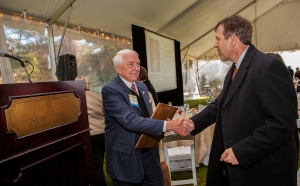 Mark Buyck receives a congratulatory handshake from Bar Foundation board member J. Calhoun Watson.